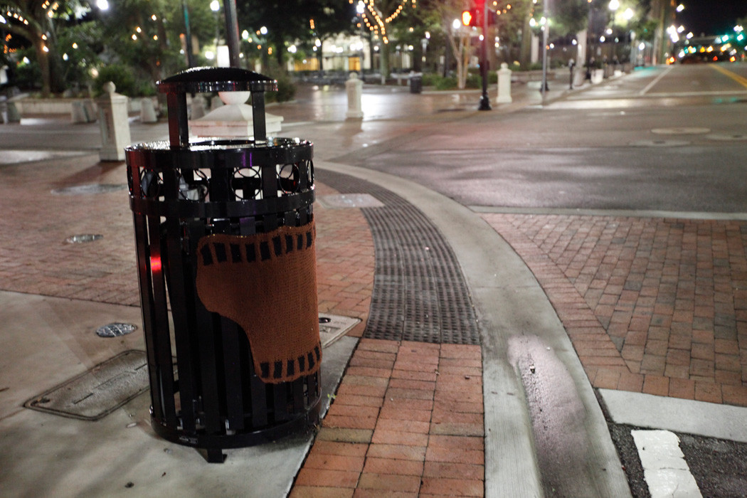 Liz Murphy Thomas created a brown film strip out of yarn to replicate a giant film canister in front of Chamblins Uptown near Hemming Plaza