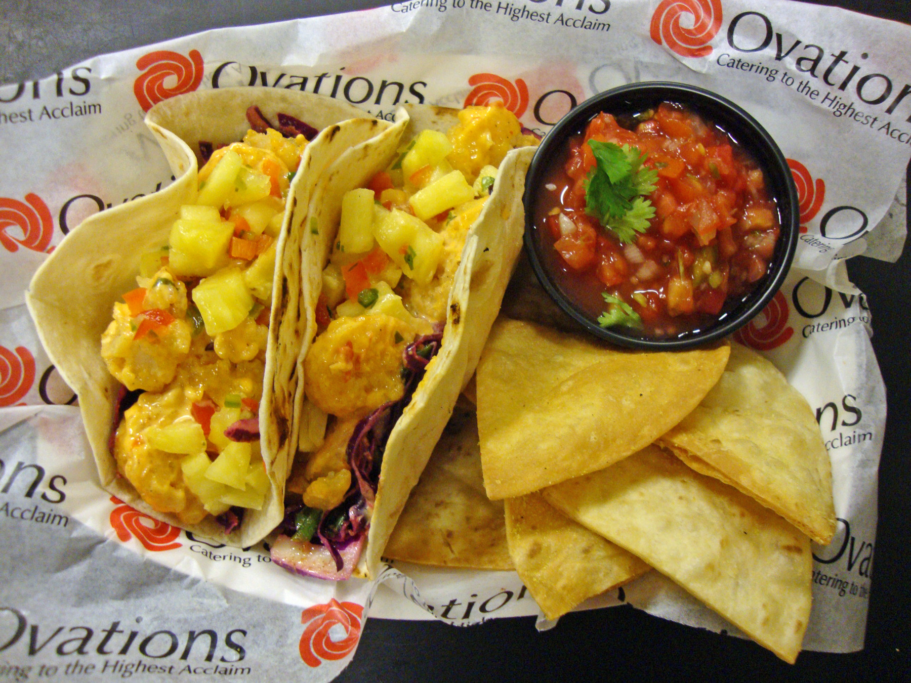 The Duval Taco Company's Big Bang Taco is loaded with spicy fried shrimp, chopped pineapple, diced red pepper and jalapeño and served on cabbage slaw marinated in a cumin-lime vinaigrette.