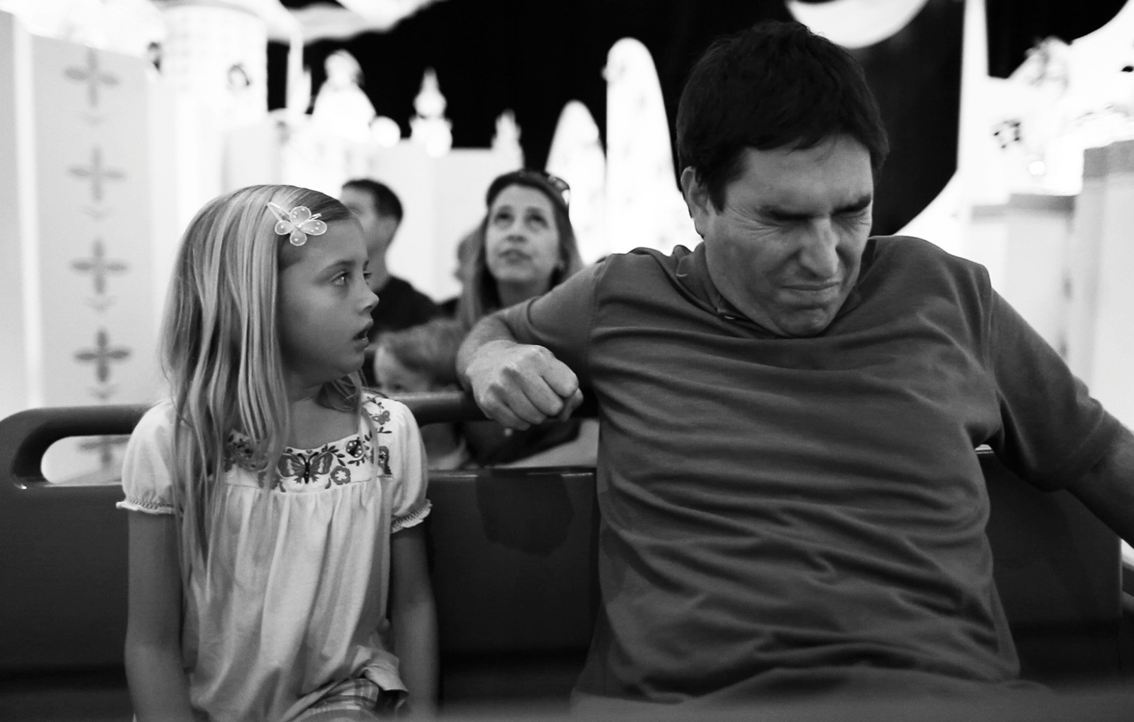 "Jim White (Roy Abramsohn, right) begins to unravel while taking his family, including daughter Sara (Katelynn Rodriguez), on a surreal trip to Disney World in the subversive ""Escape from Tomorrow."" Directed by Randy Moore and shot without Disney's permission, the film opens Oct. 18 at Sun-Ray Cinema."