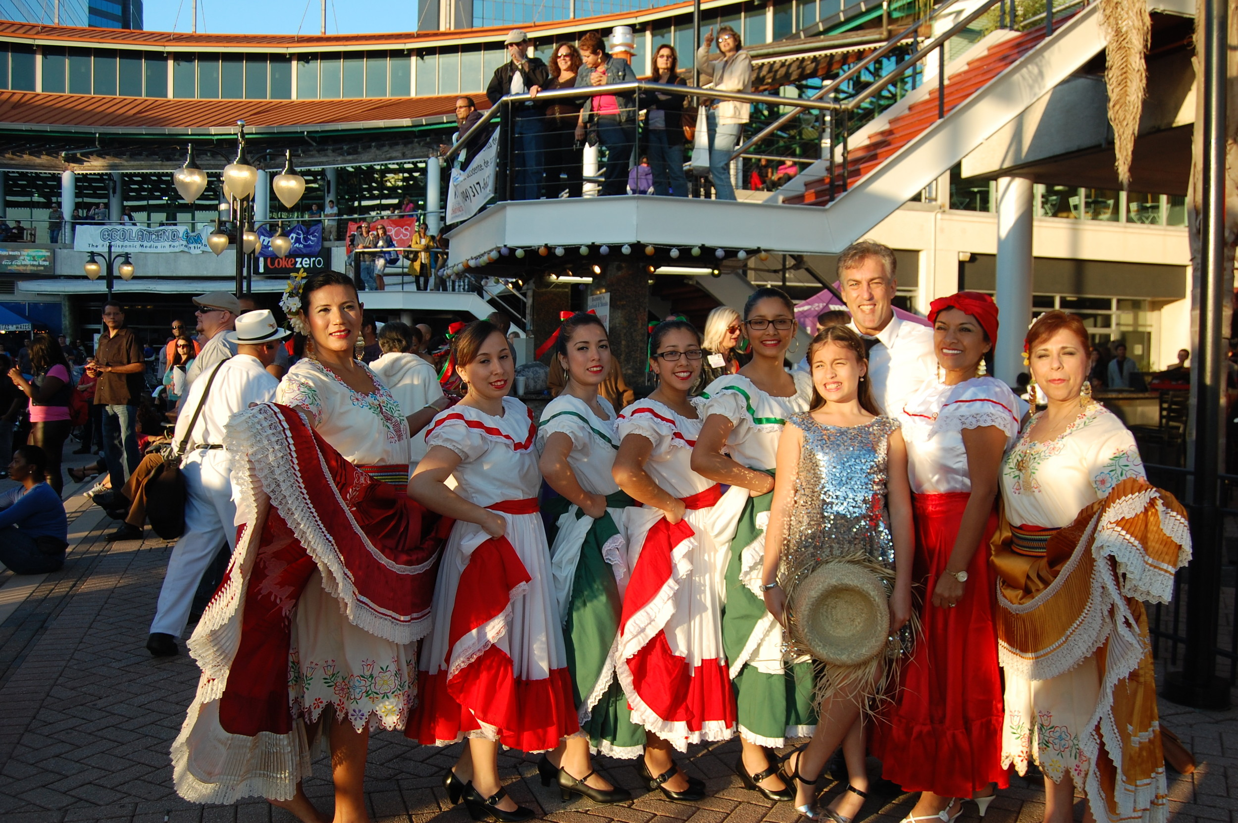 Artistic director Carlos Bouvier surrounded by cultural performers