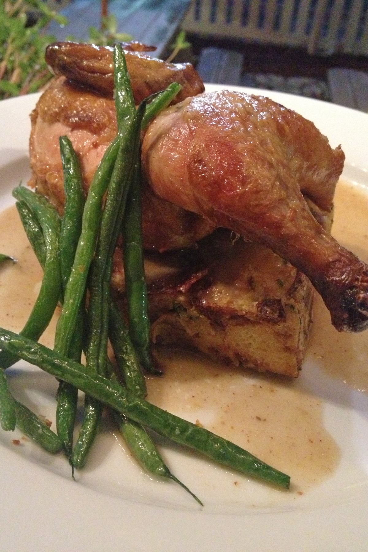 The Cornish hen with savory bread pudding and fresh green beans is one of several dinner entrées.