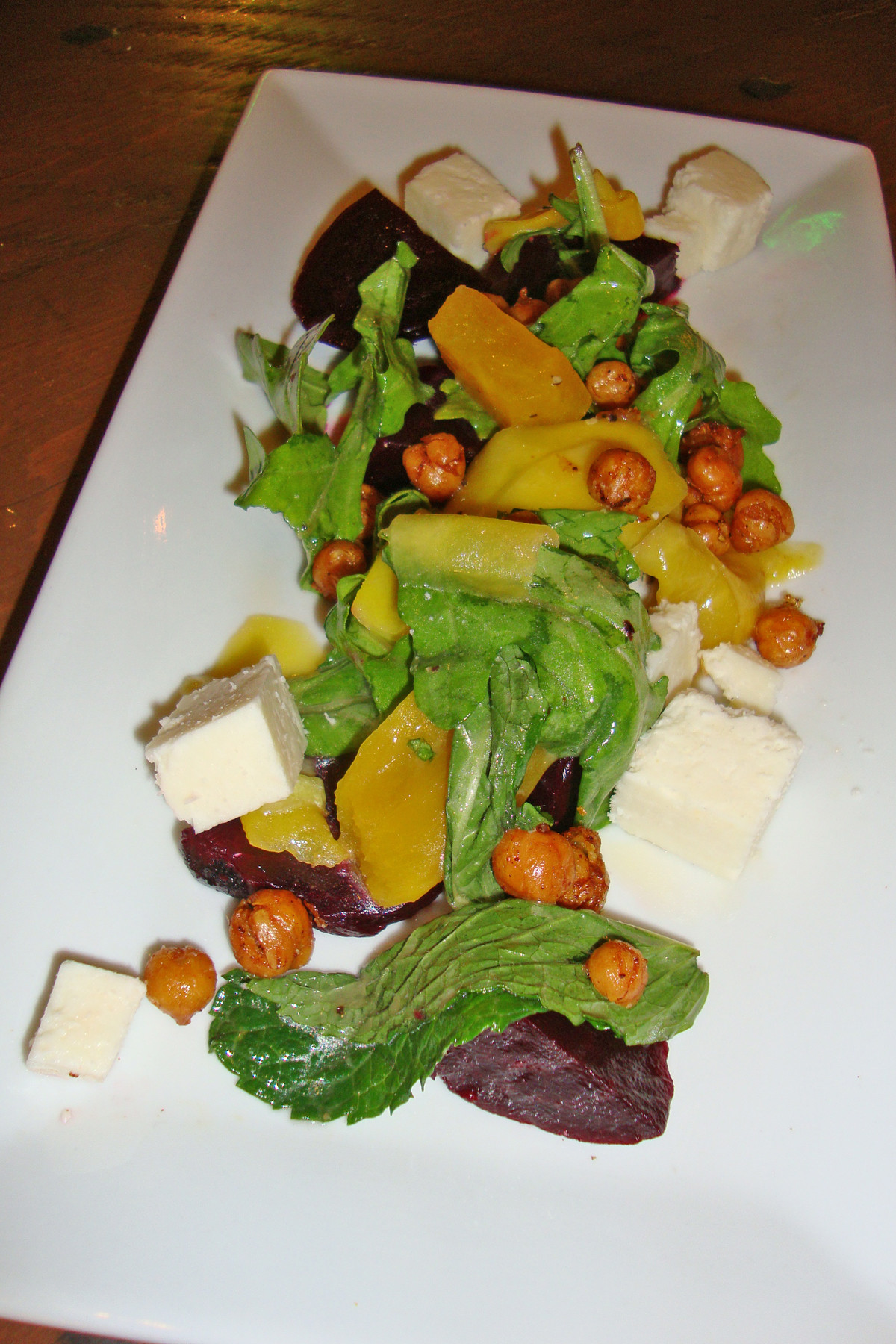 Earthy beets, roasted chickpeas, fresh mint, cubes of cotija cheese and pickled mango mingle in the roasted beet salad. There are four salad options on the menu.