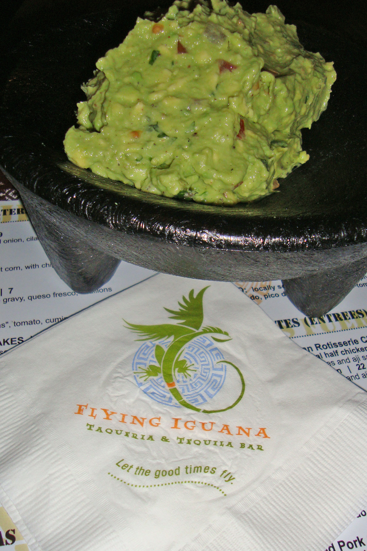 Made tableside, Flying Iguana's creamy, chunky guacamole contains ample flecks of tomato, onion and cilantro.
