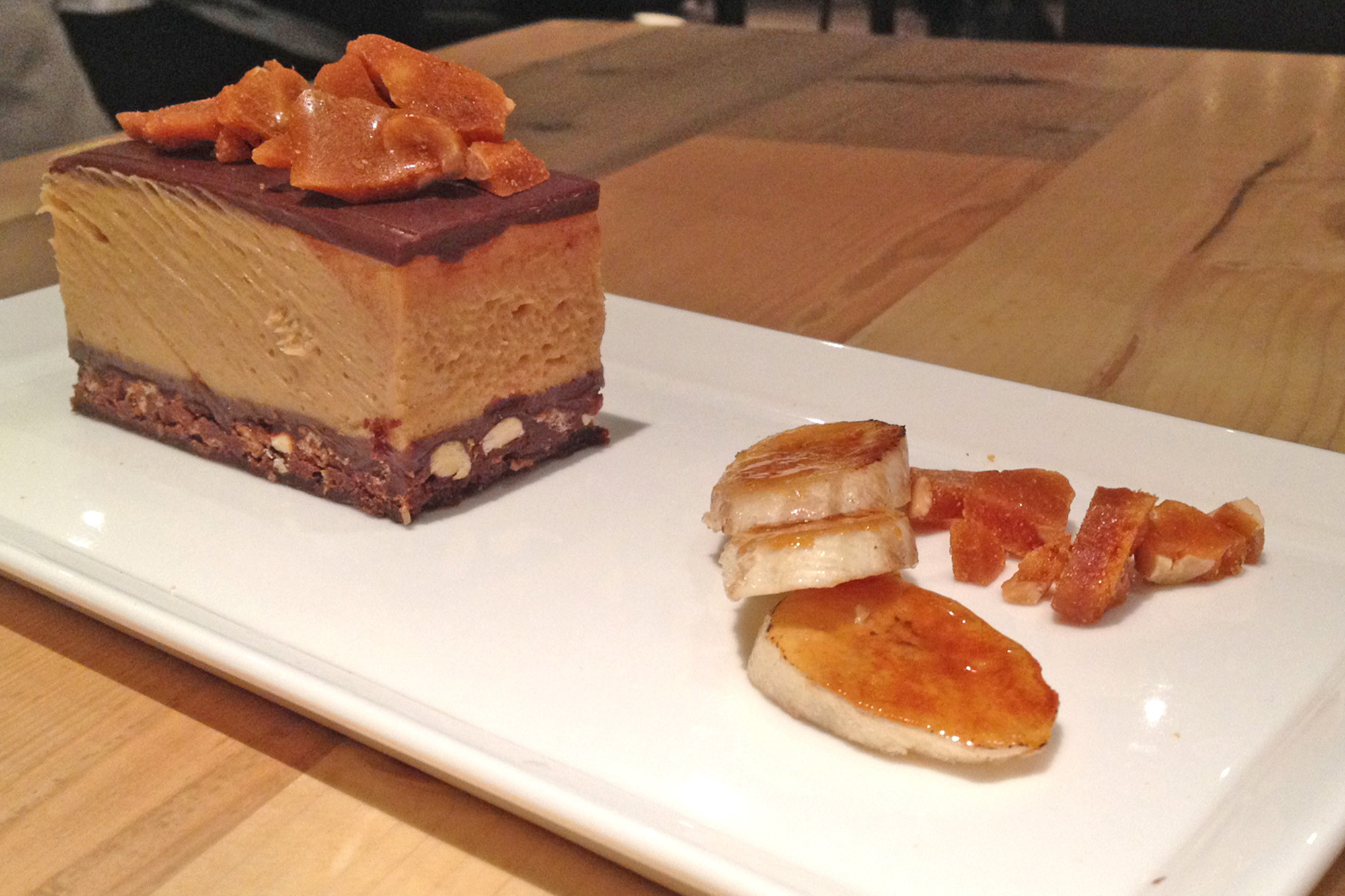 The rich peanut butter mousse stack, served with peanut butter brittle and brûléed bananas, is perfect for sharing.