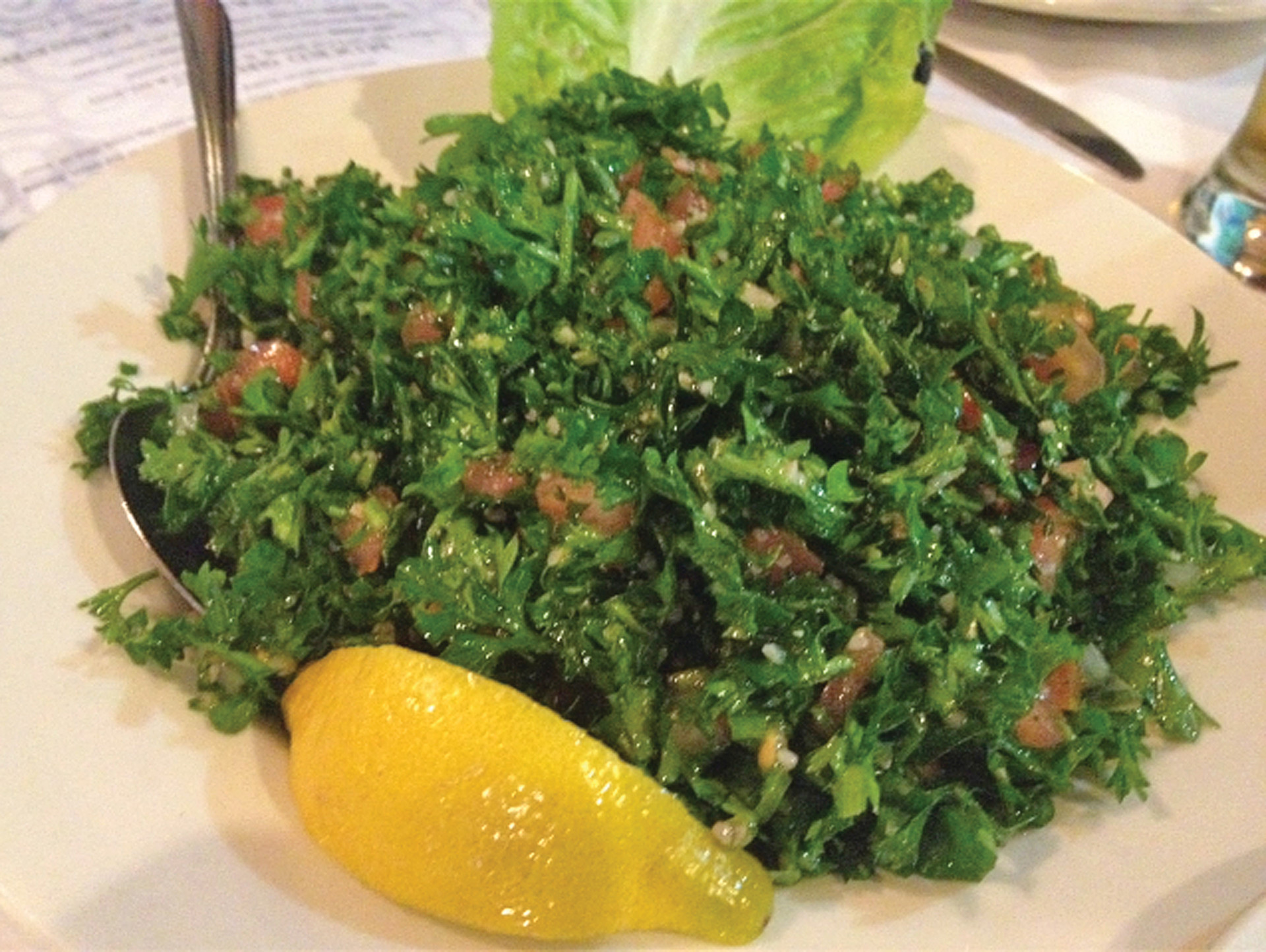 The fresh tabouli blends chopped parsley, diced tomato, onion, bulgur wheat, lemon and olive oil.
