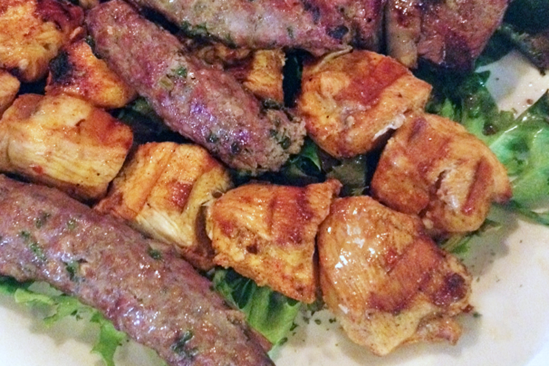 Mandaloun's various kebabs – like these chicken and minced lamb versions – are served with rice and sautéed vegetables.