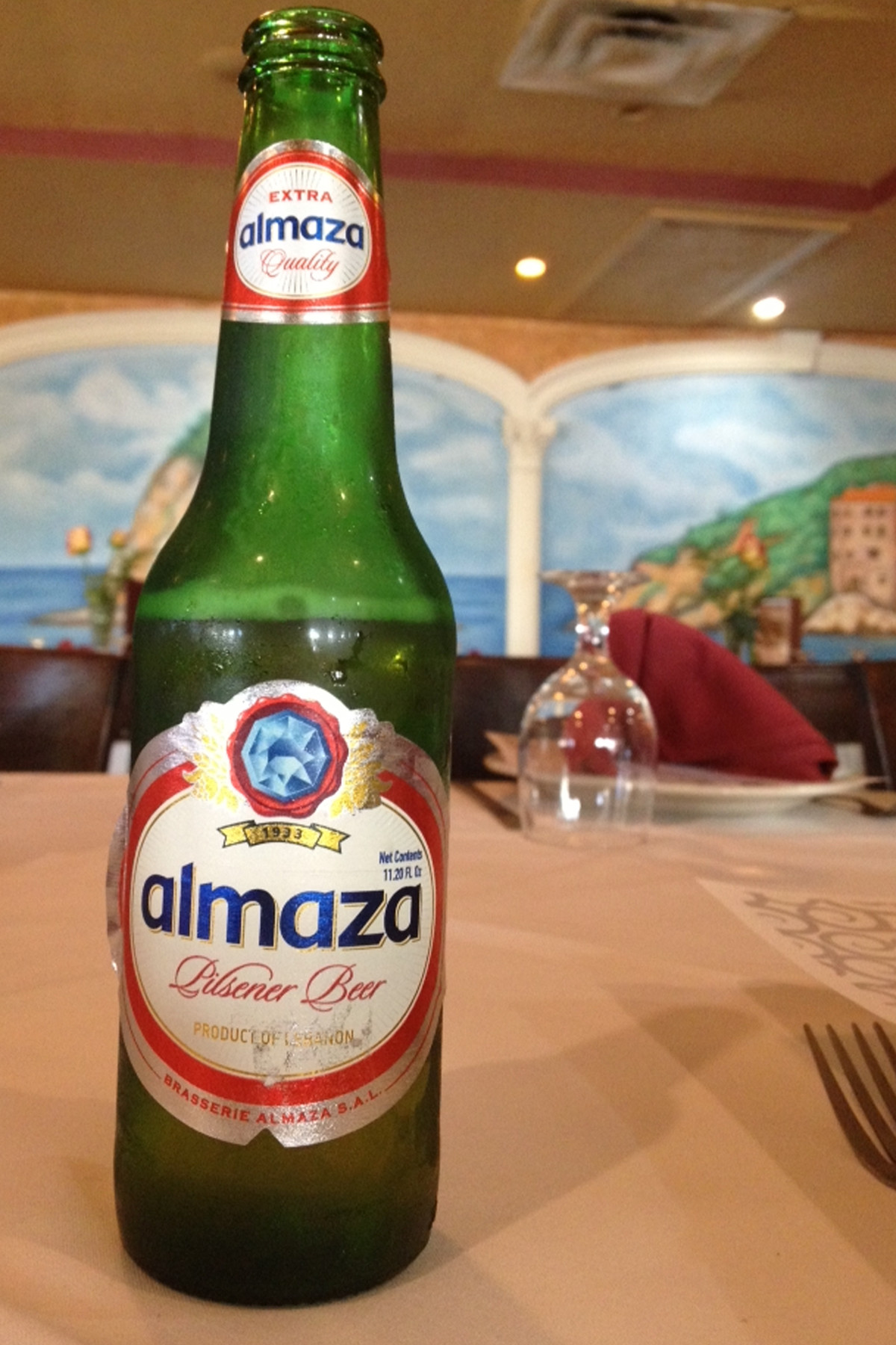 Try a cold bottle of Almaza, a pale lager beer from Lebanon.