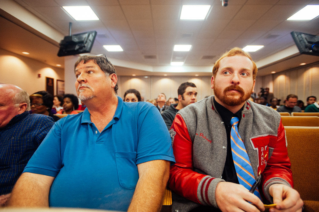 David and Tim Pickering, both Forrest High alumni, watch in dismay as the Duval County School Board unanimously votes to rename Nathan Bedford Forrest High School.