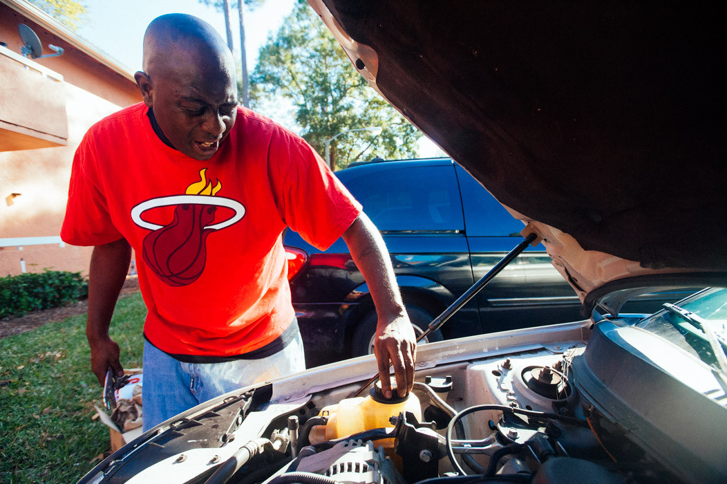 Omotoya Richmond, a registered Republican, works on his car.