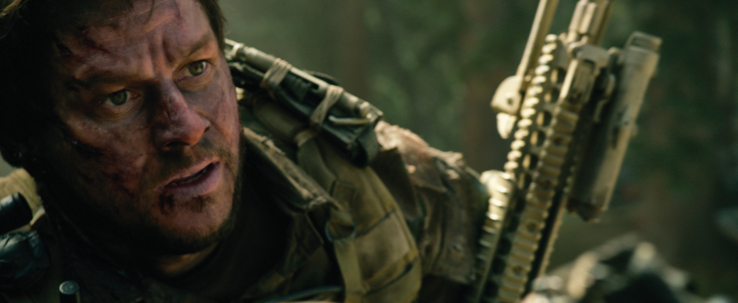"THE FUNKY BUNCH: Mark Wahlberg puts on his intense face as Marcus Luttrell in ""Lone Survivor,"" which follows four Navy SEALs on a mission to take out a Taliban operative before they're ambushed in Afghanistan."