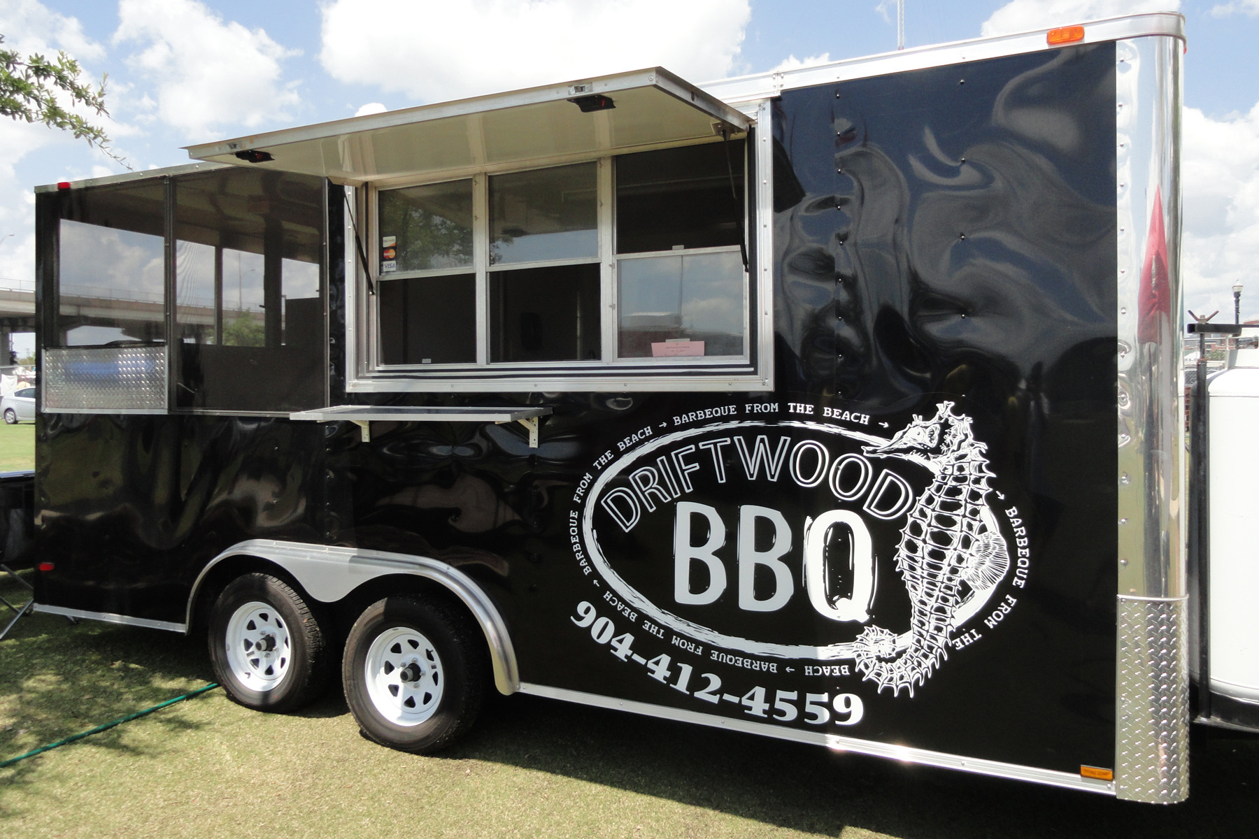 Driftwood BBQ serves a wide variety of BBQ favorites and side items — smoked ribs, pulled pork, brisket, baked beans, slaw, and occasionally the most delicious homemade banana pudding.