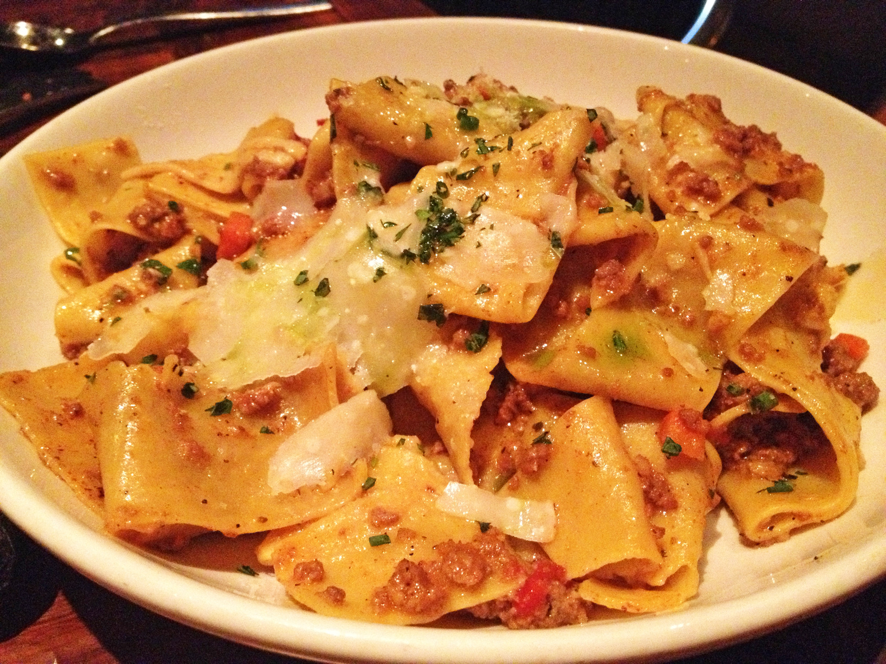 House-made pappardelle pasta with Bolognese sauce and parmigiano reggiano cheese