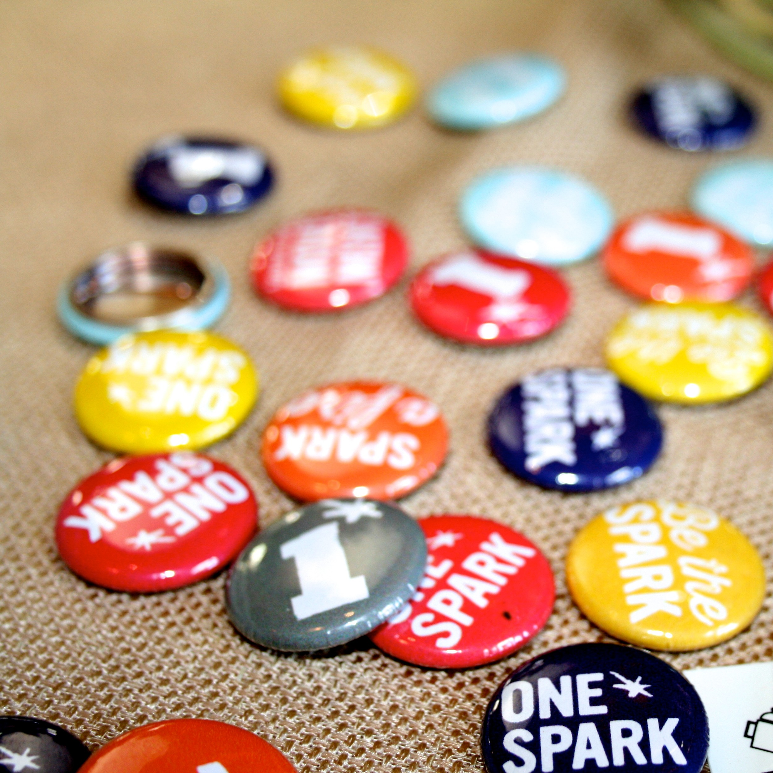 Some of the pins passed out to bring awareness to One Spark.