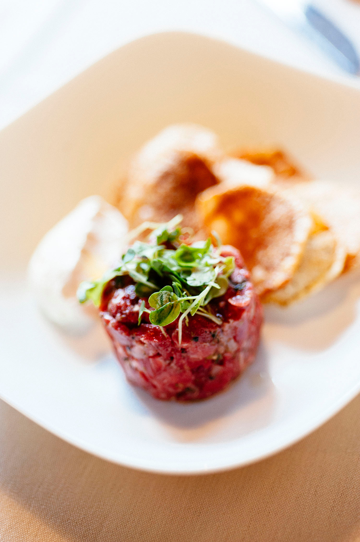 Steak Tartare with housemade chips and Dijon mousse