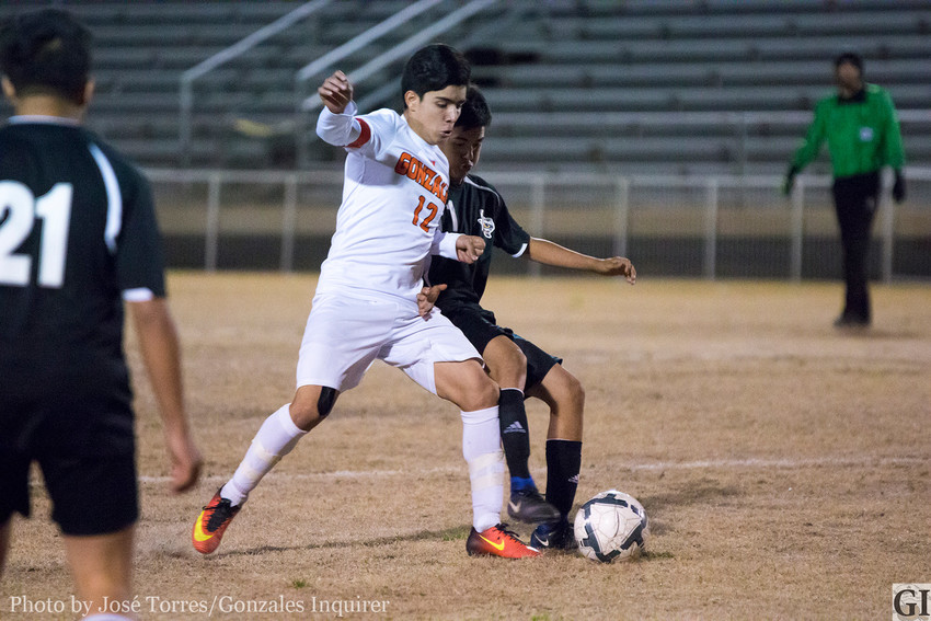 Suriel Rangel (12) fights for possession in Gonzales' 2-1 win over Sealy in a non-district game on Monday. Rangel scored both goals in the victory.