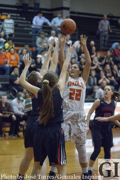 The Lady Apaches attacked the post game as senior Amanda Dixson (22) puts up a shot during Gonzales' 70-53 win over Wimberley. Dixson ended the night with eight points, four rebounds and an assist.