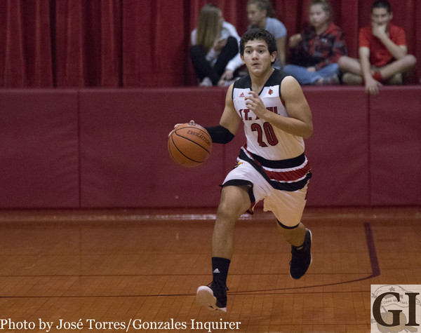 Shiner St. Paul head coach Lance Giese gave props to Joseph Natal (20) for his efforts on defense in their 47-32 win over Hallettsville Sacred Heart on Tuesday.