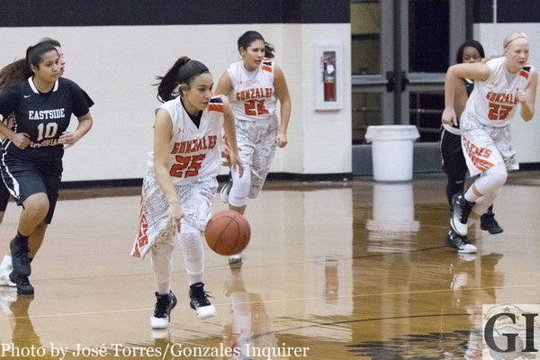 Freshman point guard Jiseala Longoria (25) drives down the court looking for a basket after a turnover. She finished the night with six points in Gonzales' 70-35 win over Austin Eastside Memorial.