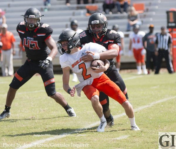 """Juan """"Bull"""" Licea (72) wraps up Bulldogs' quarterback Coleman King (2) as the Apaches' front pressured him throughout the day. Gonzales would win 21-10."""