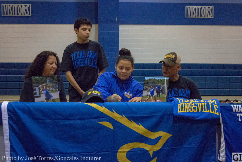 """Malorie Puente signed with Texas A&M University-Kingsville on Monday. Pictured is Puente along with her family, including her mother Norma Puente who Malorie says has """"been there all my life, ever since I was in junior high she was always at every game that I was at,"""" no matter where the game was played. """"It's something that I'm thankful for."""""""
