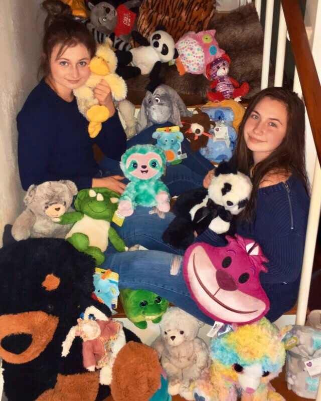 Gonzales High School students Kora, left, and Sophia Kolle have a lot of visitors at home in the form of various stuffed animals. The cuddly creatures will only be crashing at the sisters' casa for a short while, for they are destined to be donated to orphans and elderly residents in the area soon.