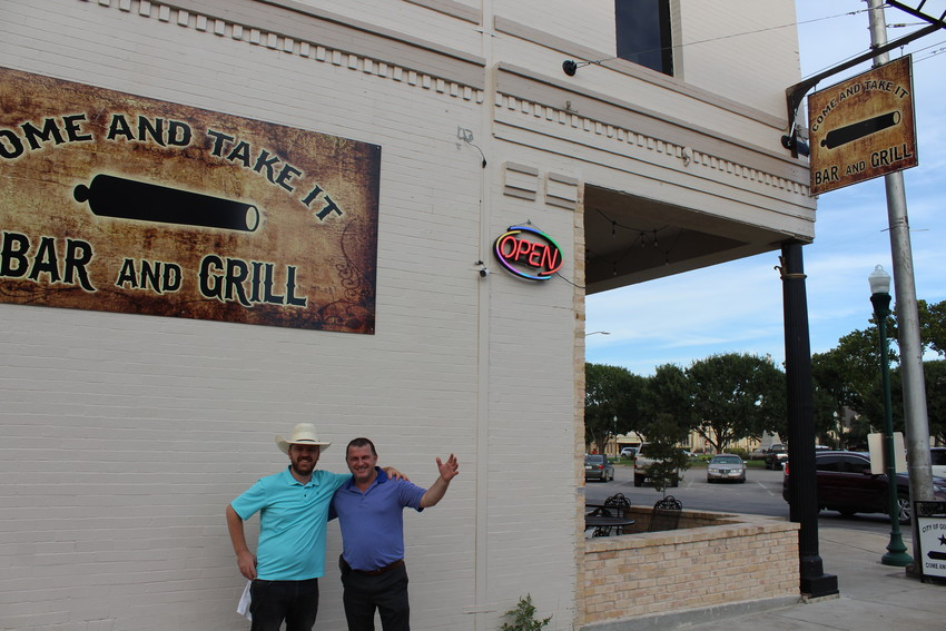 """Besard """"Besi"""" Gegaj and Gasper Lekgega are the proud proprietors of the Come and Take It sports bar/restaurant on the northwest corner of Confederate Square."""