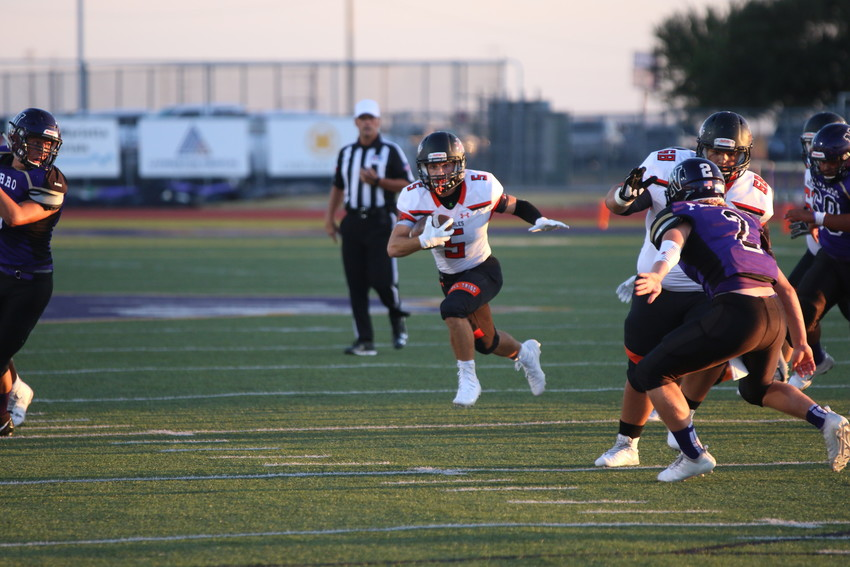 Seth Gibson finds an opening via the Apaches offensive linemen blocks.