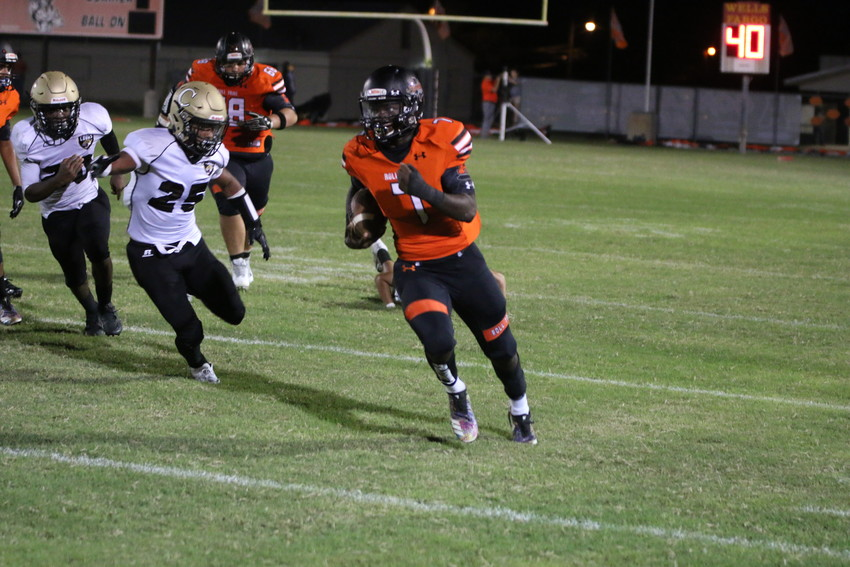Elijah Holiday (7) busts out a 59 yard touchdown run in Gonzales' 35-0 lead at the half over Austin Crockett.