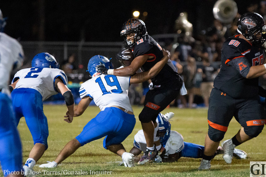 James Martinez (13) tries to break a tackle in Gonzales' 33-14 loss against Yoakum on Thursday night at Apache Field.