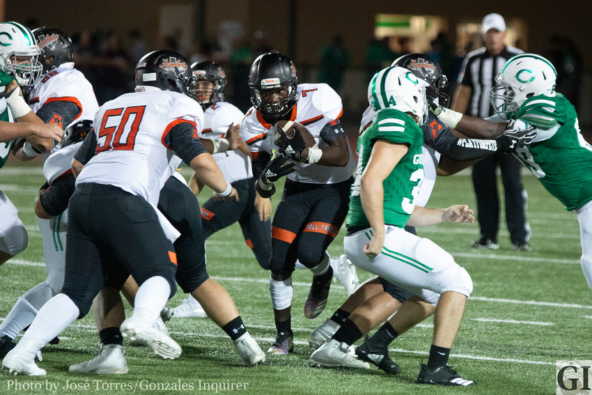 Elijah Holiday (7) tries to find a hole in Gonzales' 48-15 loss against Cuero at Gobbler Stadium.