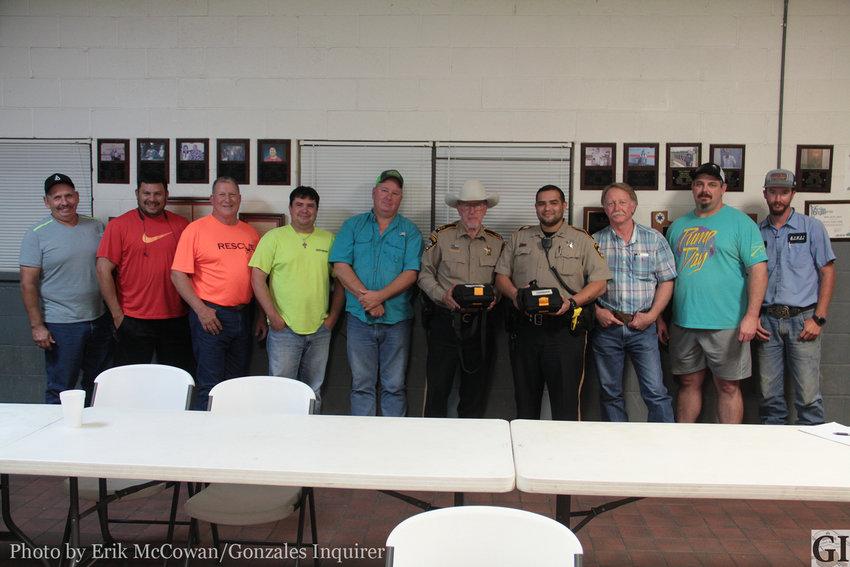 Members of Gonzales County Rescue and the Gonzales County Sheriff's Office gather to show off some new AED devices.