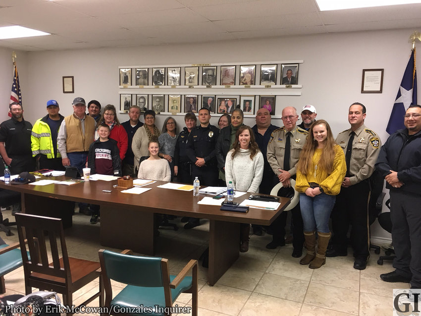 The City of Nixon issued a proclamation for Grace Morgan Day at their Monday night meeting. Morgan was the linchpin of a toy drive this past holiday season that brought gifts to children across the county who otherwise might have gone without. Here council, the Nixon Police Department, Gonzales County Sheriff's Department, Gonzales County EMS, and assorted officials took time to thank her for her efforts. Morgan is seated behind the gavel in the mayor's chair.