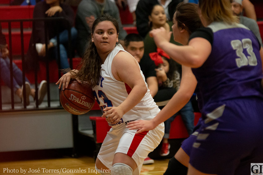"""Gracelyn Mejia (23) looks for an opening in Nixon-Smiley's 39-37 district win over their rivals last Friday. Mejia was the team's last starter to foul out, getting """"some great rebounds for us, got some big steals, hit some crucial free throws for us down the stretch,"""" head coach Doug Boatright said after the game."""