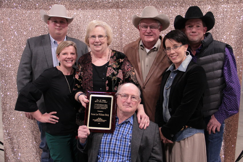 Norma Ehrig is surrounded by her family as she accepts the David B. Walshak Lifetime Achievement Award at the recent Gonzales Chamber of Commerce banquet.