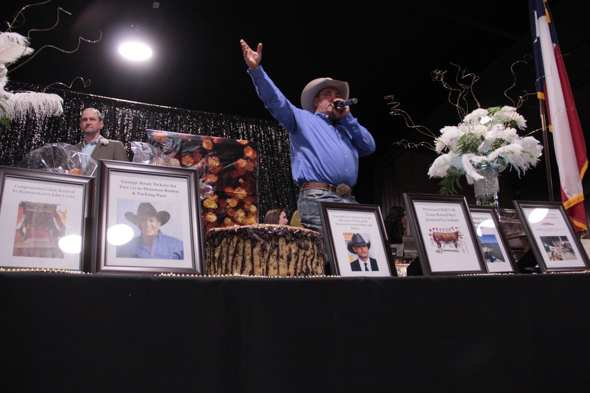 At Friday's annual chamber banquet, J.D. Shelton conducted a lively auction with assistance from emcee Egon Barthels. Items from Tim McGraw and George Strait tickets were available, as well as fishing trips, fresh beef, and a Texas Capitol chair donated by State Rep. John Cyrier.