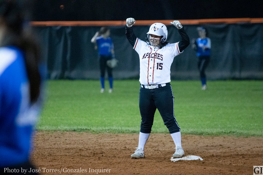 Freshman Josselyn Estrada (15) celebrates an RBI double that sparked a scoring run in the bottom of the second inning for the Lady Apaches. Gonzales would lose 27-5 against La Vernia last Friday.