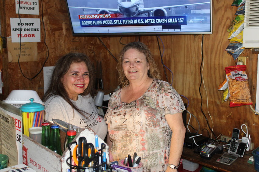 Rosie Brown of Gonzales has purchased Boomers Sports Bar and changed the name to Spanky's, the nickname of her husband Keith. Pictured are Elvira Heinemeyer and Rosie Brown.