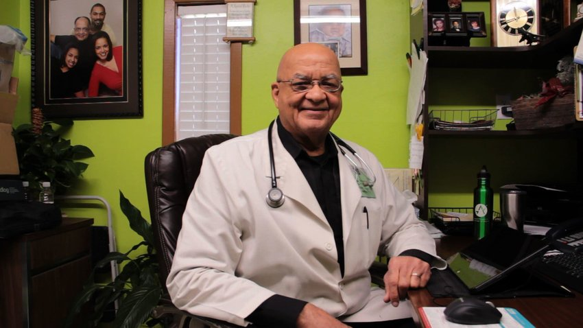 CUTLINE: Dr. Garth O. Vaz takes a break in his busy, down-home office to chat about some of the exciting things going on in his clinic.
