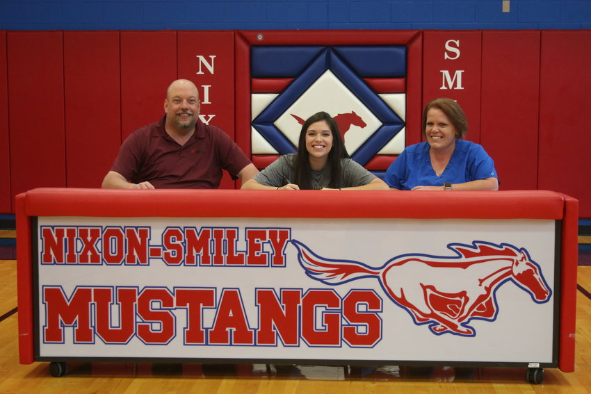 Pictured (from left) are Merle Campbell, Caitlin Sandoval and Rebecca Campbell as Sandoval signs her letter of intent for Texas Lutheran University.