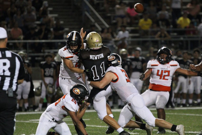 The Apaches defensive line frustrated Austin Crockett in Gonzales' 14-0 win over the Cougars on Friday at Burger Stadium.