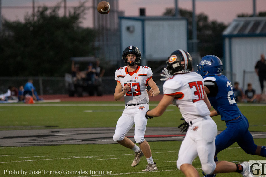 Quarterback Heath Henke (23) finds Jared Cook (30) off a play-action pass early in the first half. The Apaches would win 27-25 against the Yoakum Bulldogs.