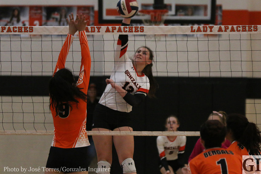 Hayley Sample (13) goes up for a kill in Gonzales' three-set victory over SA Brooks Academy, (25-4, 25-5, 25-10).