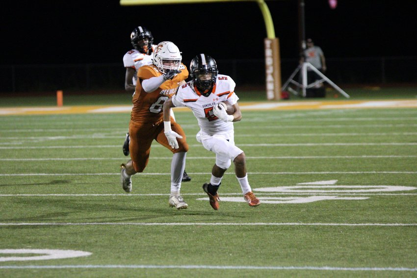 Adrian Rodriguez (5) returns an interception in Gonzales' 27-3 loss against Beeville on Friday.