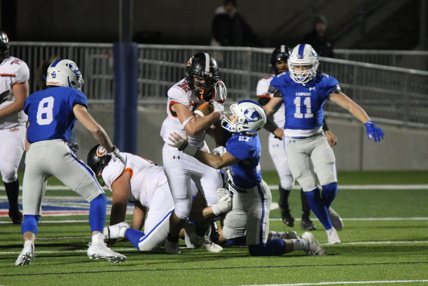 Diego Diaz de Leon (32) runs through a defender deep in their own territory in the first half. The senior Apache had the team's biggest play of the night, a 45-yard rush in the third quarter that led to a touchdown.