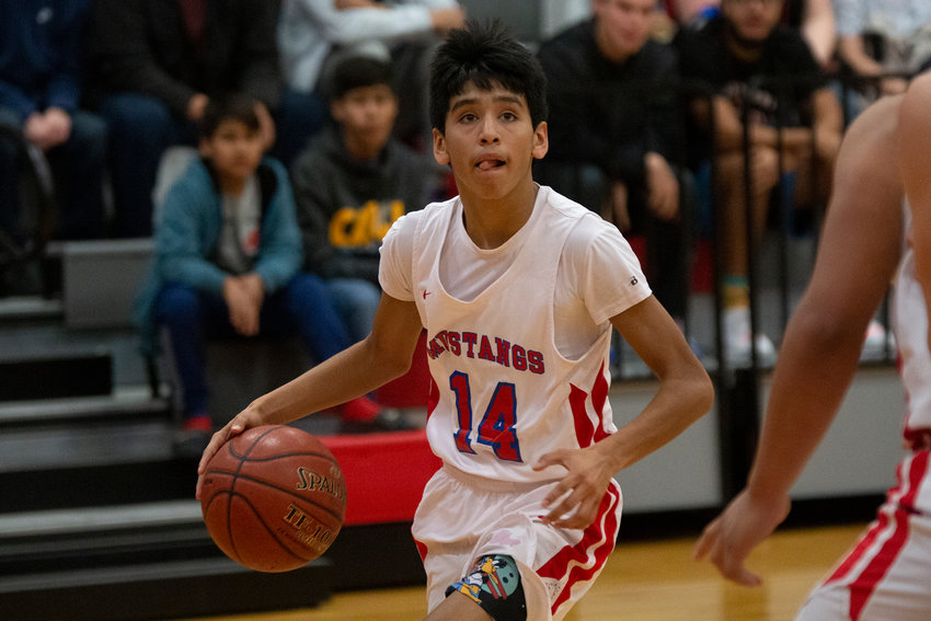 Brayden Martinez (14) looks to shoot in Nixon-Smiley's 53-33 loss against Poth on Tuesday.