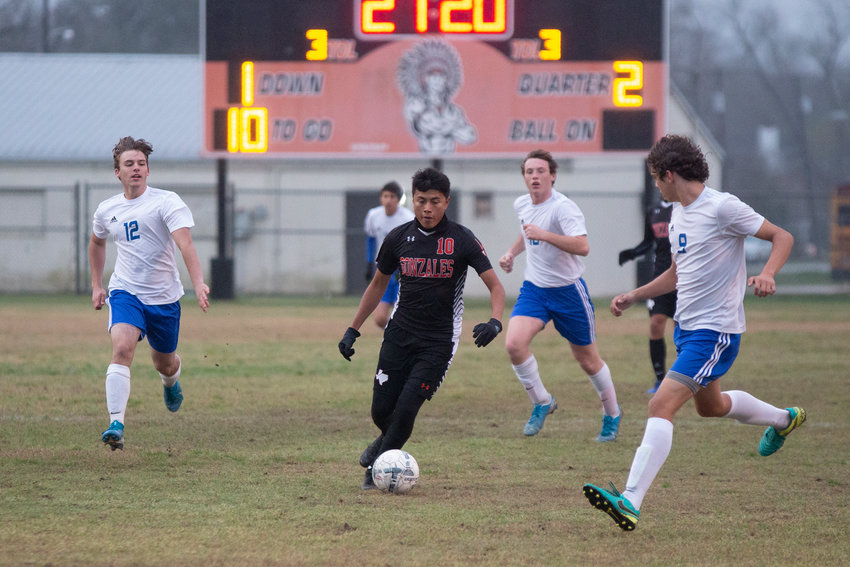 Daniel Cruz (10) dribbles down the field in Gonzales' 5-2 victory over Bandera on Tuesday. Cruz came away with three goals in the win.