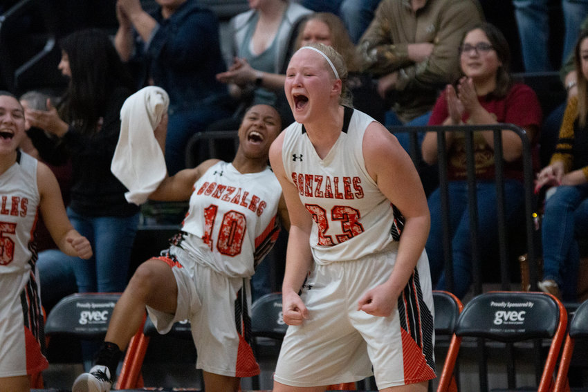 Devon Williams (23) celebrates a shot being made by her teammates on the court in Gonzales' 47-19 victory over Pleasanton last Friday. The Lady Apaches open playoffs with a bi-district matchup against Hondo next Tuesday, Feb. 18 at Floresville. Tipoff is scheduled for 7 p.m.