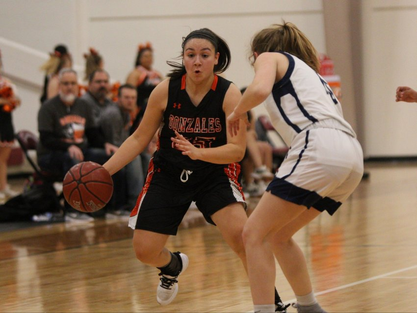 """Jiseala """"Chella"""" Longoria dribbles past a defender in Gonzales' 54-34 victory over Hondo on Tuesday. Longoria led the team in scoring with 13 points."""