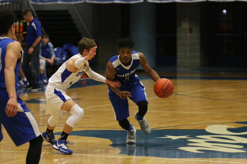 Isaiah Jones-Miller drives by a McMullen County defender in Waelder's 66-52 victory on Tuesday. Jones-Miller finished the night with 16 points, tied for a team best with Colby Thorne.