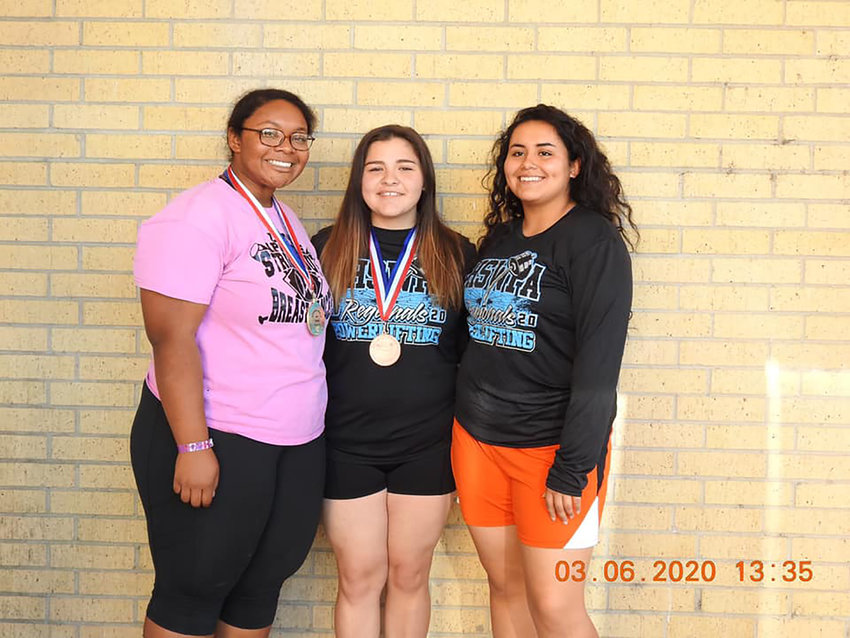 Pictured are the Gonzales Lady Apaches lifters who competed in the regional powerlifting meet last week. Sydney Clack (left) is the regional powerlifting champion in her weight class. Graycee Center (middle) placed fifth in her weight class and Trinity Aguero (right) placed ninth in her weight class.